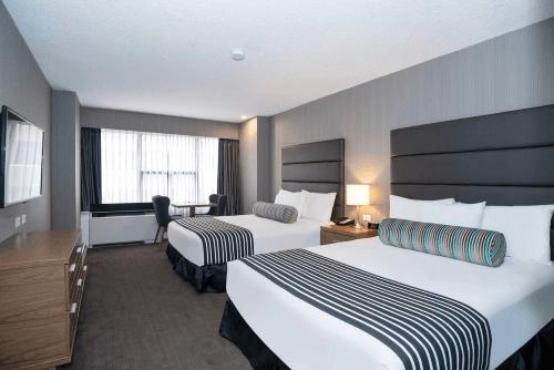 sandman hotel calgary city centre kamer.png